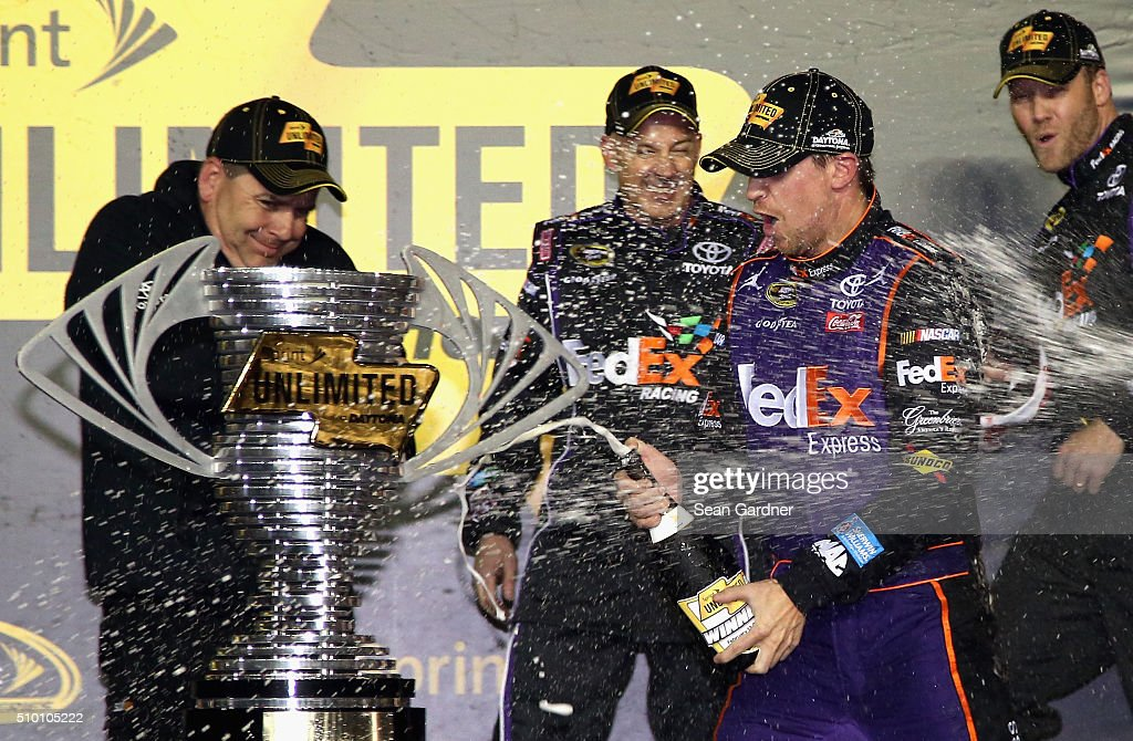 Denny Hamlin, driver of the #11 FedEx Express Toyota, celebrates with members of his crew in Victory Lane after winning the NASCAR Sprint Cup Series Sprint Unlimited at Daytona International Speedway on February 13, 2016 in Daytona Beach, Florida.