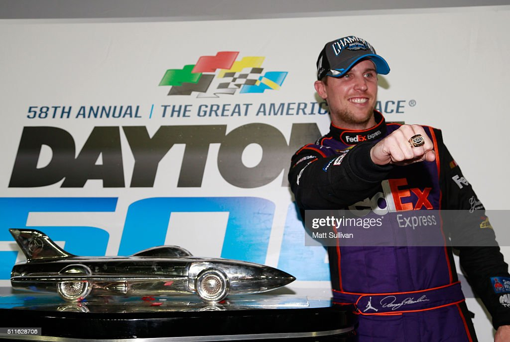 Denny Hamlin, driver of the #11 FedEx Express Toyota, celebrates with the Harley J. Earl Trophy and shows off his champion's ring in Victory Lane after winning the NASCAR Sprint Cup Series DAYTONA 500 at Daytona International Speedway on February 21, 2016 in Daytona Beach, Florida.