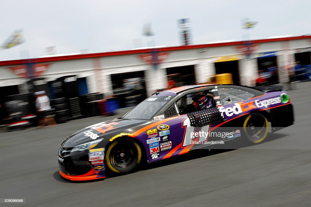 <a gi-track='captionPersonalityLinkClicked' href=/galleries/search?phrase=Denny+Hamlin&family=editorial&specificpeople=504674 ng-click='$event.stopPropagation()'>Denny Hamlin</a>, driver of the #11 FedEx Express Toyota, drives through the garage area during practice for the NASCAR Sprint Cup Series GEICO 500 at Talladega Superspeedway on April 29, 2016 in Talladega, Alabama.