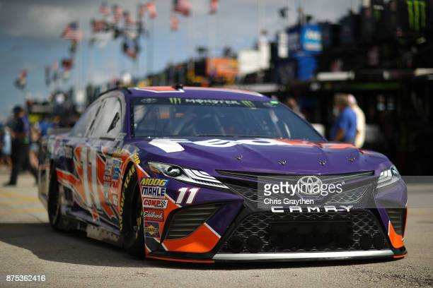 Denny Hamlin driver of the FedEx Express Toyota drives through the garage area during practice for the Monster Energy NASCAR Cup Series Championship...