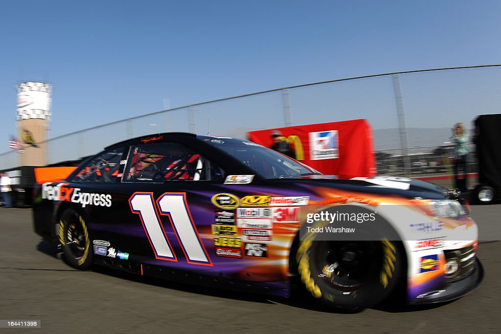 Denny Hamlin, driver of the #11 FedEx Express Toyota, drives to the garage area during practice for the NASCAR Sprint Cup Series Auto Club 400 at Auto Club Speedway on March 23, 2013 in Fontana, California.