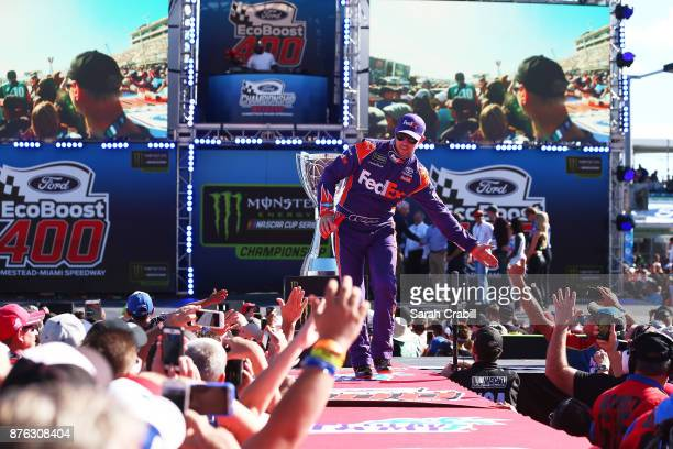 Denny Hamlin driver of the FedEx Express Toyota greets fans during driver introductions for the Monster Energy NASCAR Cup Series Championship Ford...