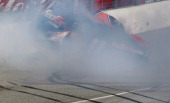 Denny Hamlin driver of the FedEx Express Toyota hits the wall after colliding with Joey Logano driver of the AAA Southern California Ford on the...