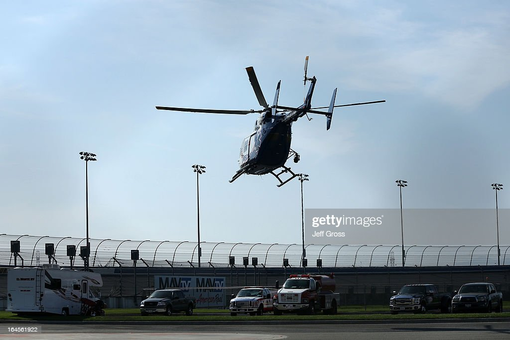 Denny Hamlin, driver of the #11 FedEx Express Toyota, is air-lifted out by medical staff after an incident on track with Joey Logano (not pictured), driver of the #22 AAA Southern California Ford, after the NASCAR Sprint Cup Series Auto Club 400 at Auto Club Speedway on March 24, 2013 in Fontana, California.
