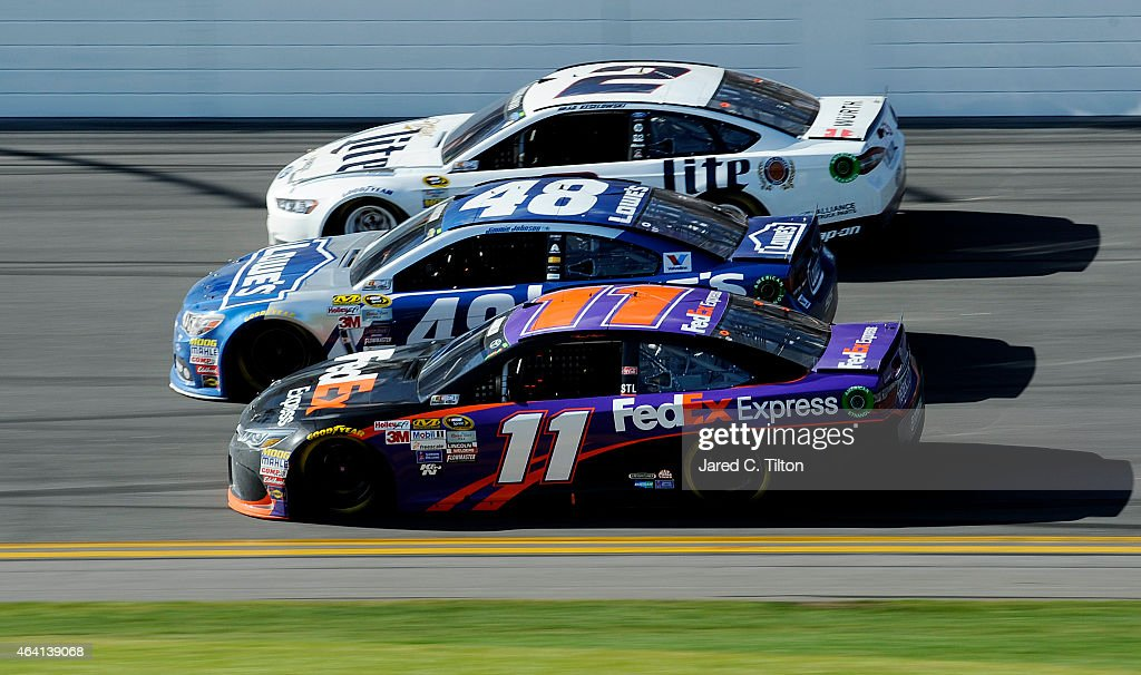 <a gi-track='captionPersonalityLinkClicked' href=/galleries/search?phrase=Denny+Hamlin&family=editorial&specificpeople=504674 ng-click='$event.stopPropagation()'>Denny Hamlin</a>, driver of the #11 FedEx Express Toyota, <a gi-track='captionPersonalityLinkClicked' href=/galleries/search?phrase=Jimmie+Johnson+-+Nascar+Race+Driver&family=editorial&specificpeople=171519 ng-click='$event.stopPropagation()'>Jimmie Johnson</a>, driver of the #48 Lowe's Chevrolet, and <a gi-track='captionPersonalityLinkClicked' href=/galleries/search?phrase=Brad+Keselowski&family=editorial&specificpeople=890258 ng-click='$event.stopPropagation()'>Brad Keselowski</a>, driver of the #2 Miller Lite Ford, race three-wide during the NASCAR Sprint Cup Series 57th Annual Daytona 500 at Daytona International Speedway on February 22, 2015 in Daytona Beach, Florida.