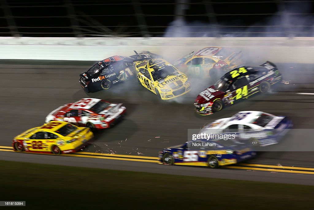 <a gi-track='captionPersonalityLinkClicked' href=/galleries/search?phrase=Denny+Hamlin&family=editorial&specificpeople=504674 ng-click='$event.stopPropagation()'>Denny Hamlin</a>, driver of the #11 FedEx Express Toyota, <a gi-track='captionPersonalityLinkClicked' href=/galleries/search?phrase=Kyle+Busch&family=editorial&specificpeople=211123 ng-click='$event.stopPropagation()'>Kyle Busch</a>, driver of the #18 M&M's Toyota, <a gi-track='captionPersonalityLinkClicked' href=/galleries/search?phrase=Jeff+Gordon&family=editorial&specificpeople=171491 ng-click='$event.stopPropagation()'>Jeff Gordon</a>, driver of the #24 Drive To End Hunger Chevrolet, <a gi-track='captionPersonalityLinkClicked' href=/galleries/search?phrase=Mark+Martin&family=editorial&specificpeople=204455 ng-click='$event.stopPropagation()'>Mark Martin</a>, driver of the #55 Aaron's Dream Machine Toyota, <a gi-track='captionPersonalityLinkClicked' href=/galleries/search?phrase=Martin+Truex+Jr.&family=editorial&specificpeople=184514 ng-click='$event.stopPropagation()'>Martin Truex Jr.</a>, driver of the #56 NAPA Auto Parts Toyota, <a gi-track='captionPersonalityLinkClicked' href=/galleries/search?phrase=Joey+Logano&family=editorial&specificpeople=4510426 ng-click='$event.stopPropagation()'>Joey Logano</a>, driver of the #22 Shell-Pennzoil Ford, and <a gi-track='captionPersonalityLinkClicked' href=/galleries/search?phrase=Jimmie+Johnson+-+Nascar+Race+Driver&family=editorial&specificpeople=171519 ng-click='$event.stopPropagation()'>Jimmie Johnson</a>, driver of the #48 Lowe's Yellow Chevrolet, are involved in an incident during the NASCAR Sprint Cup Series Sprint Unlimited at Daytona International Speedway on February 16, 2013 in Daytona Beach, Florida.
