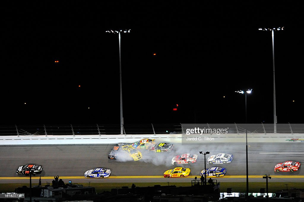 <a gi-track='captionPersonalityLinkClicked' href=/galleries/search?phrase=Denny+Hamlin&family=editorial&specificpeople=504674 ng-click='$event.stopPropagation()'>Denny Hamlin</a>, driver of the #11 FedEx Express Toyota, <a gi-track='captionPersonalityLinkClicked' href=/galleries/search?phrase=Kyle+Busch&family=editorial&specificpeople=211123 ng-click='$event.stopPropagation()'>Kyle Busch</a>, driver of the #18 M&M's Toyota, <a gi-track='captionPersonalityLinkClicked' href=/galleries/search?phrase=Jeff+Gordon&family=editorial&specificpeople=171491 ng-click='$event.stopPropagation()'>Jeff Gordon</a>, driver of the #24 Drive To End Hunger Chevrolet, <a gi-track='captionPersonalityLinkClicked' href=/galleries/search?phrase=Kevin+Harvick&family=editorial&specificpeople=209186 ng-click='$event.stopPropagation()'>Kevin Harvick</a>, driver of the #29 Budweiser Chevrolet, and <a gi-track='captionPersonalityLinkClicked' href=/galleries/search?phrase=Jimmie+Johnson+-+Nascar+Race+Driver&family=editorial&specificpeople=171519 ng-click='$event.stopPropagation()'>Jimmie Johnson</a>, driver of the #48 Lowe's Yellow Chevrolet, are involved in an incident during the NASCAR Sprint Cup Series Sprint Unlimited at Daytona International Speedway on February 16, 2013 in Daytona Beach, Florida.