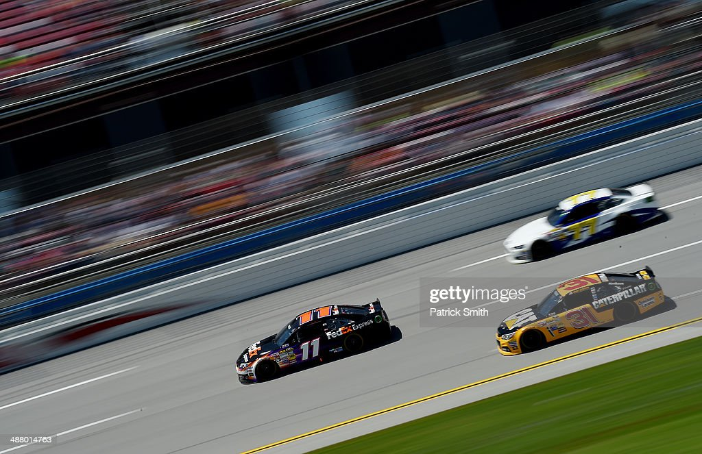 <a gi-track='captionPersonalityLinkClicked' href=/galleries/search?phrase=Denny+Hamlin&family=editorial&specificpeople=504674 ng-click='$event.stopPropagation()'>Denny Hamlin</a>, driver of the #11 FedEx Express Toyota, leads a pack of cars during qualifying for the NASCAR Sprint Cup Series Aaron's 499 at Talladega Superspeedway on May 3, 2014 in Talladega, Alabama.