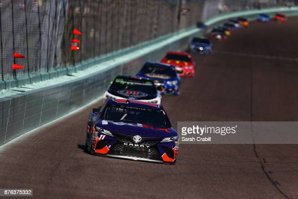 Denny Hamlin driver of the FedEx Express Toyota leads Kevin Harvick driver of the Jimmy John's Ford and others during the Monster Energy NASCAR Cup...