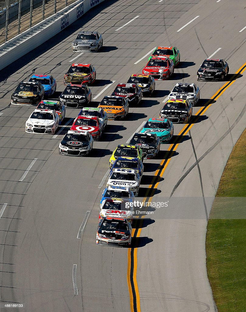 Denny Hamlin, driver of the #11 FedEx Express Toyota, leads the field during the NASCAR Sprint Cup Series Aaron's 499 at Talladega Superspeedway on May 4, 2014 in Talladega, Alabama.