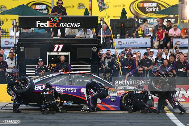 Denny Hamlin driver of the FedEx Express Toyota pits during qualifying for the NASCAR Sprint Cup Series Sprint AllStar Race at Charlotte Motor...