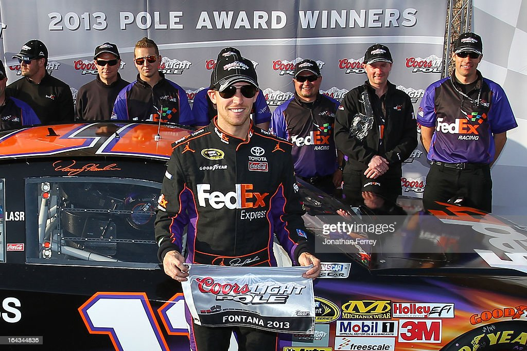 <a gi-track='captionPersonalityLinkClicked' href=/galleries/search?phrase=Denny+Hamlin&family=editorial&specificpeople=504674 ng-click='$event.stopPropagation()'>Denny Hamlin</a>, driver of the #11 FedEx Express Toyota, poses after qualifying for the pole position in the NASCAR Sprint Cup Series Auto Club 400 at Auto Club Speedway on March 22, 2013 in Fontana, California.
