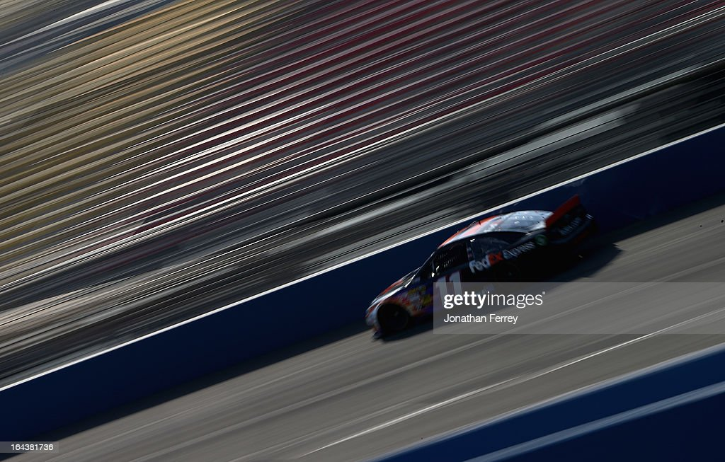 <a gi-track='captionPersonalityLinkClicked' href=/galleries/search?phrase=Denny+Hamlin&family=editorial&specificpeople=504674 ng-click='$event.stopPropagation()'>Denny Hamlin</a>, driver of the #11 FedEx Express Toyota, practices for the NASCAR Sprint Cup Series Auto Club 400 at Auto Club Speedway on March 23, 2013 in Fontana, California.