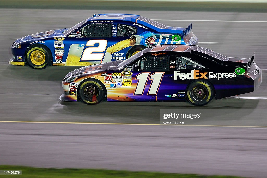<a gi-track='captionPersonalityLinkClicked' href=/galleries/search?phrase=Denny+Hamlin&family=editorial&specificpeople=504674 ng-click='$event.stopPropagation()'>Denny Hamlin</a>, driver of the #11 FedEx Express Toyota, races <a gi-track='captionPersonalityLinkClicked' href=/galleries/search?phrase=Brad+Keselowski&family=editorial&specificpeople=890258 ng-click='$event.stopPropagation()'>Brad Keselowski</a>, driver of the #2 Miller Lite Dodge, during the NASCAR Sprint Cup Series Quaker State 400 at Kentucky Speedway on June 30, 2012 in Sparta, Kentucky.
