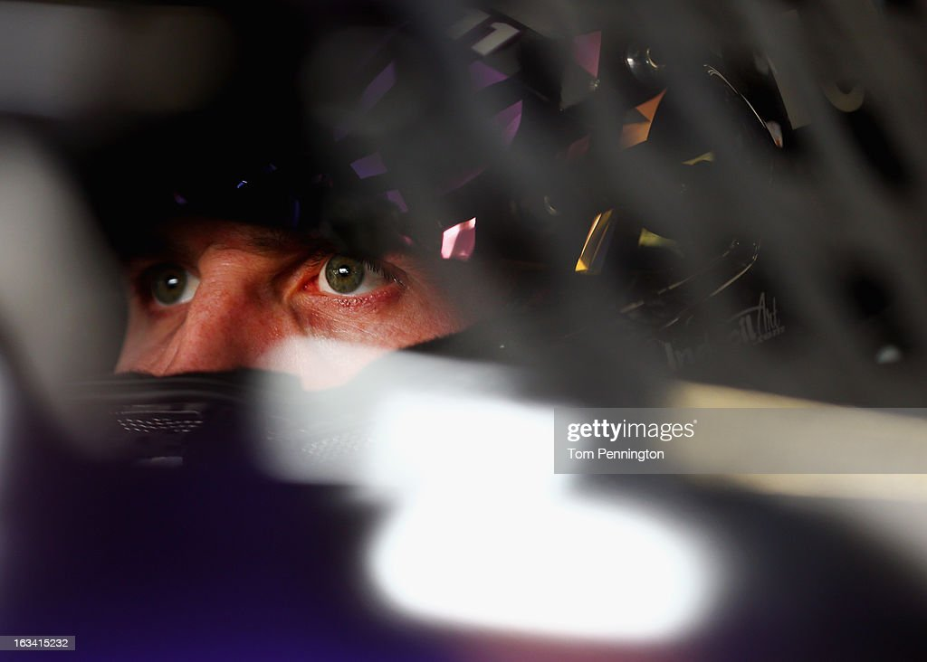 <a gi-track='captionPersonalityLinkClicked' href=/galleries/search?phrase=Denny+Hamlin&family=editorial&specificpeople=504674 ng-click='$event.stopPropagation()'>Denny Hamlin</a>, driver of the #11 FedEx Express Toyota, sits in his car in the garage area during practice for the NASCAR Sprint Cup Series Kobalt Tools 400 at Las Vegas Motor Speedway on March 9, 2013 in Las Vegas, Nevada.