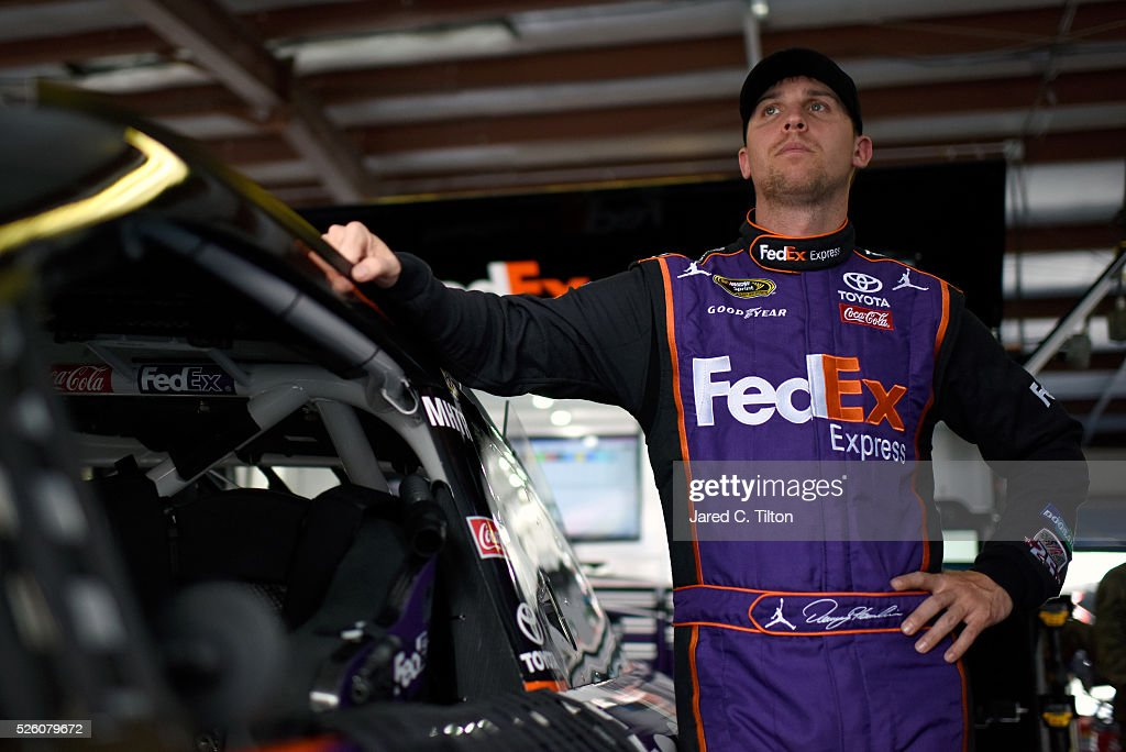 Denny Hamlin, driver of the #11 FedEx Express Toyota, stands in the garage area during practice for the NASCAR Sprint Cup Series GEICO 500 at Talladega Superspeedway on April 29, 2016 in Talladega, Alabama.