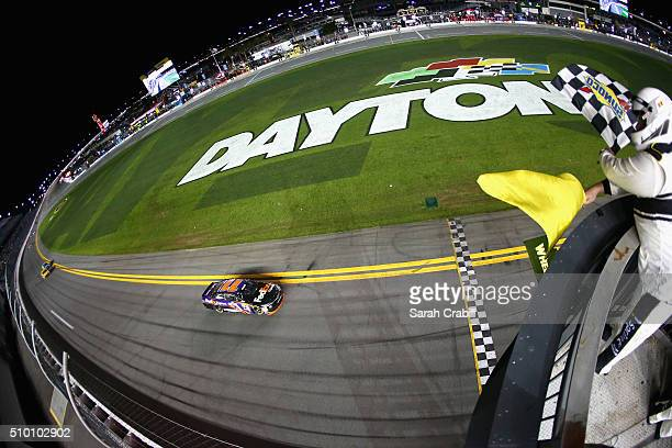 Denny Hamlin driver of the FedEx Express Toyota takes the checkered flag to win the NASCAR Sprint Cup Series Sprint Unlimited at Daytona...