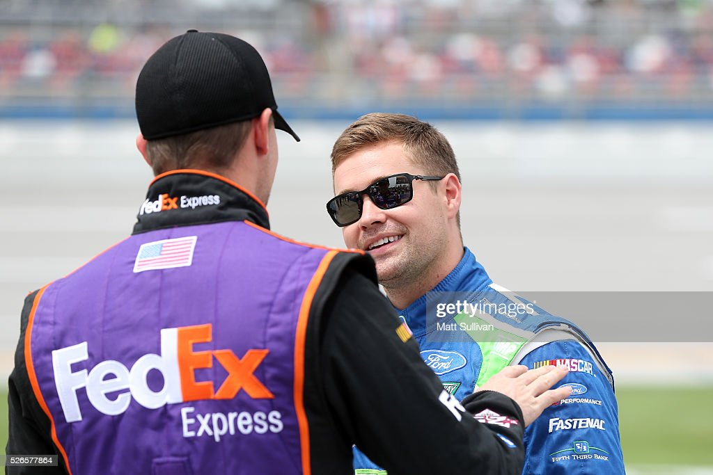 Denny Hamlin, driver of the #11 FedEx Express Toyota, talks to Ricky Stenhouse Jr, driver of the #17 Fifth Third Bank Ford, on the grid during qualifying for the NASCAR Sprint Cup Series GEICO 500 at Talladega Superspeedway on April 30, 2016 in Talladega, Alabama.