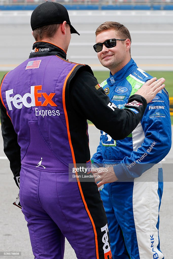 <a gi-track='captionPersonalityLinkClicked' href=/galleries/search?phrase=Denny+Hamlin&family=editorial&specificpeople=504674 ng-click='$event.stopPropagation()'>Denny Hamlin</a>, driver of the #11 FedEx Express Toyota, talks to Ricky Stenhouse Jr, driver of the #17 Fifth Third Bank Ford, on the grid during qualifying for the NASCAR Sprint Cup Series GEICO 500 at Talladega Superspeedway on April 30, 2016 in Talladega, Alabama.