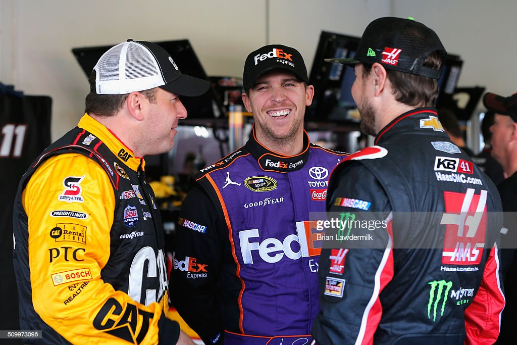 <a gi-track='captionPersonalityLinkClicked' href=/galleries/search?phrase=Denny+Hamlin&family=editorial&specificpeople=504674 ng-click='$event.stopPropagation()'>Denny Hamlin</a>, driver of the #11 FedEx Express Toyota, talks with <a gi-track='captionPersonalityLinkClicked' href=/galleries/search?phrase=Kurt+Busch&family=editorial&specificpeople=201728 ng-click='$event.stopPropagation()'>Kurt Busch</a>, driver of the #41 Haas Automation/Monster Energy Chevrolet, and <a gi-track='captionPersonalityLinkClicked' href=/galleries/search?phrase=Ryan+Newman+-+Race+Car+Driver&family=editorial&specificpeople=12773547 ng-click='$event.stopPropagation()'>Ryan Newman</a>, driver of the #31 CAT Chevrolet, during practice for the NASCAR Sprint Cup Series Daytona 500 at Daytona International Speedway on February 13, 2016 in Daytona Beach, Florida.