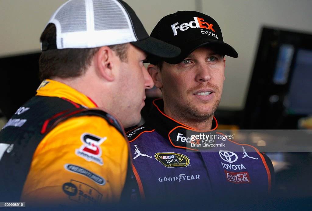 <a gi-track='captionPersonalityLinkClicked' href=/galleries/search?phrase=Denny+Hamlin&family=editorial&specificpeople=504674 ng-click='$event.stopPropagation()'>Denny Hamlin</a>, driver of the #11 FedEx Express Toyota, talks with <a gi-track='captionPersonalityLinkClicked' href=/galleries/search?phrase=Ryan+Newman+-+Race+Car+Driver&family=editorial&specificpeople=12773547 ng-click='$event.stopPropagation()'>Ryan Newman</a>, driver of the #31 CAT Chevrolet, in the garage area during practice for the NASCAR Sprint Cup Series Daytona 500 at Daytona International Speedway on February 13, 2016 in Daytona Beach, Florida.