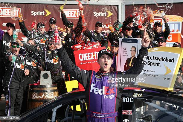 Denny Hamlin driver of the FedEx Freight Toyota celebrates in victory lane after winning the NASCAR Sprint Cup Series CheezIt 355 at Watkins Glen...