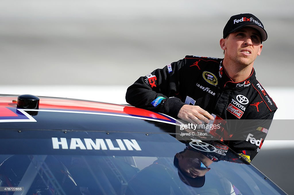 <a gi-track='captionPersonalityLinkClicked' href=/galleries/search?phrase=Denny+Hamlin&family=editorial&specificpeople=504674 ng-click='$event.stopPropagation()'>Denny Hamlin</a>, driver of the #11 FedEx Freight Toyota, climbs out of his car during qualifying for the NASCAR Sprint Cup Series Food City 500 at Bristol Motor Speedway on March 14, 2014 in Bristol, Tennessee.