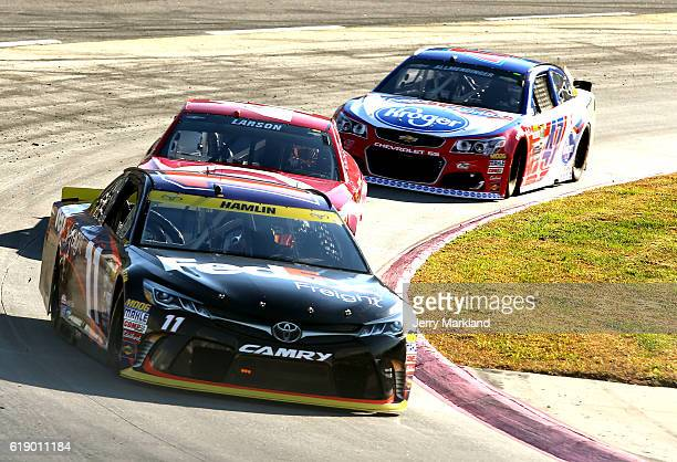 Denny Hamlin driver of the FedEx Freight Toyota Kyle Larson driver of the Target Chevrolet and AJ Allmendinger driver of the Kroger/Clorox Chevrolet...