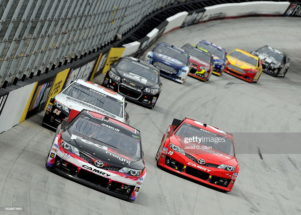 Denny Hamlin, driver of the #11 FedEx Freight Toyota, leads a group of cars during the NASCAR Sprint Cup Food City 500 at Bristol Motor Speedway on March 17, 2013 in Bristol, Tennessee.