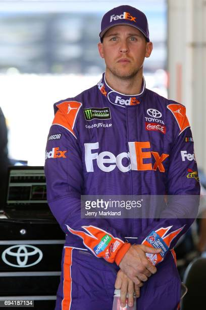 Denny Hamlin driver of the FedEx Freight Toyota looks on during practice for the Monster Energy NASCAR Cup Series Axalta presents the Pocono 400 at...