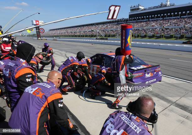 Denny Hamlin driver of the FedEx Freight Toyota pits during the Monster Energy NASCAR Cup Series Axalta presents the Pocono 400 at Pocono Raceway on...