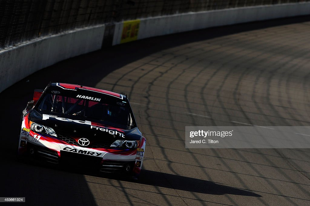 Denny Hamlin, driver of the #11 FedEx Freight Toyota, qualifies for the NASCAR Sprint Cup Series Pure Michigan 400 at Michigan International Speedway on August 15, 2014 in Brooklyn, Michigan.