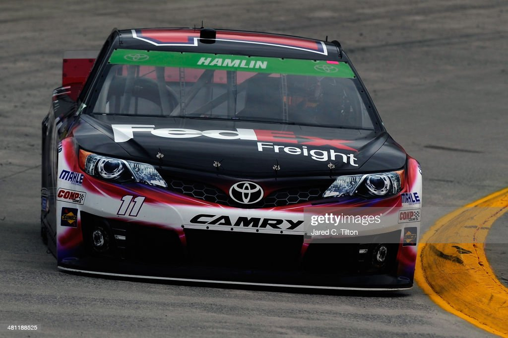 Denny Hamlin, driver of the #11 FedEx Freight Toyota, qualifies for the NASCAR Sprint Cup Series STP 500 at Martinsville Speedway on March 28, 2014 in Martinsville, Virginia.