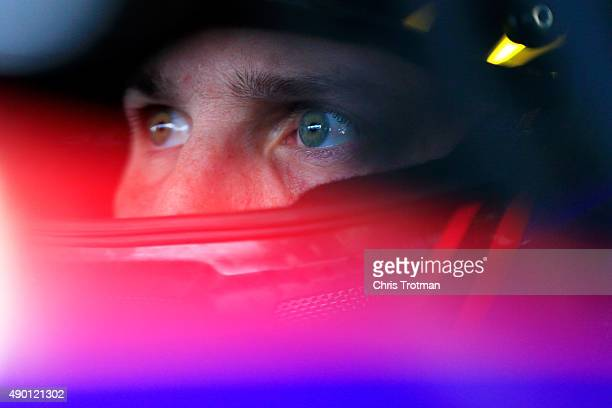 Denny Hamlin driver of the FedEx Freight Toyota sits in his car during practice for the NASCAR Sprint Cup Series Sylvania 300 at New Hampshire Motor...