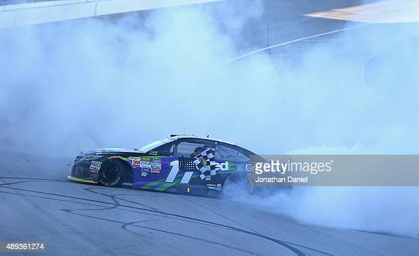 Denny Hamlin driver of the FedEx Ground Toyota celebrates with a burnout after winning the NASCAR Sprint Cup Series myAFibRiskcom 400 at Chicagoland...