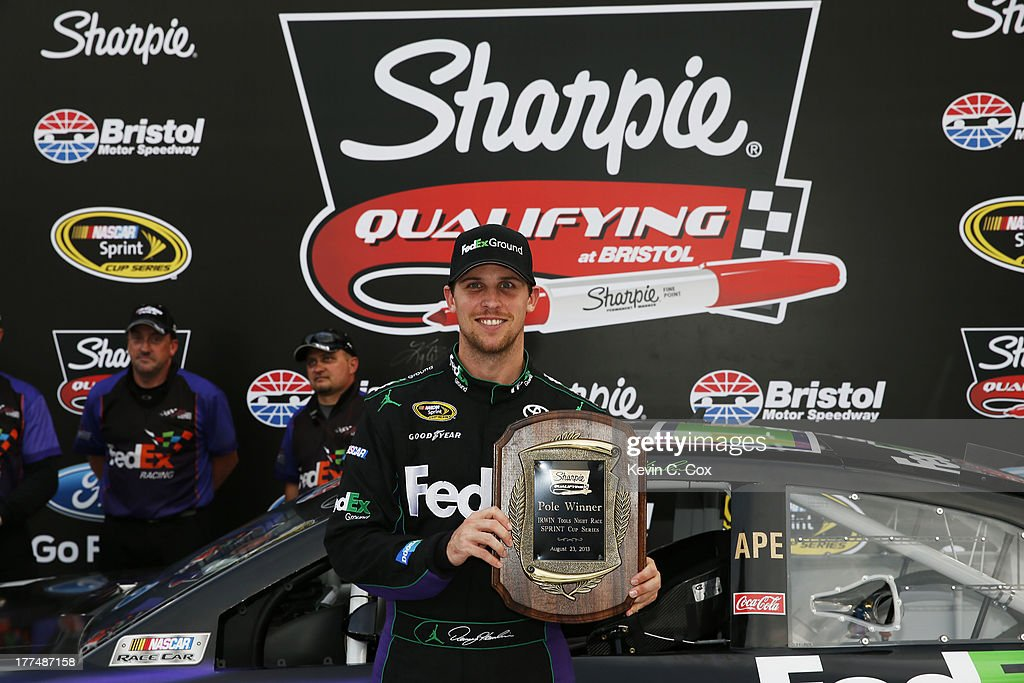 <a gi-track='captionPersonalityLinkClicked' href=/galleries/search?phrase=Denny+Hamlin&family=editorial&specificpeople=504674 ng-click='$event.stopPropagation()'>Denny Hamlin</a>, driver of the #11 FedEx Ground Toyota, celebrates with the Sharpie Pole Award after qualifying for the pole for the NASCAR Sprint Cup Series IRWIN Tools Night Race at Bristol Motor Speedway on August 23, 2013 in Bristol, Tennessee.