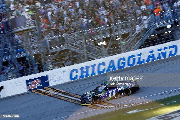 Denny Hamlin driver of the FedEx Ground Toyota crosses the finishline to win the NASCAR Sprint Cup Series myAFibRiskcom 400 at Chicagoland Speedway...