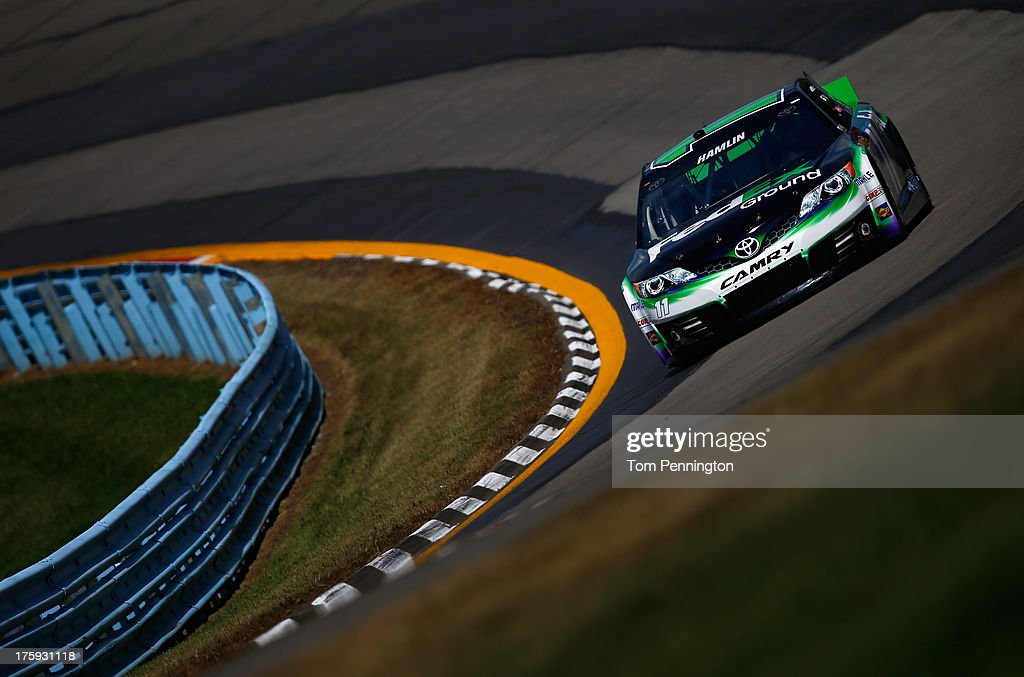 <a gi-track='captionPersonalityLinkClicked' href=/galleries/search?phrase=Denny+Hamlin&family=editorial&specificpeople=504674 ng-click='$event.stopPropagation()'>Denny Hamlin</a>, driver of the #11 FedEx Ground Toyota, drives during qualifying for the NASCAR Sprint Cup Series Cheez-It 355 at The Glen at Watkins Glen International on August 10, 2013 in Watkins Glen, New York.