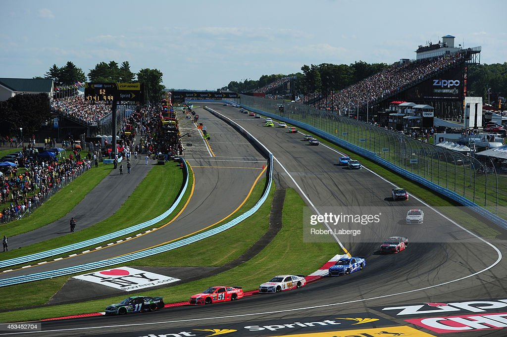 Denny Hamlin driver of the FedEx Ground Toyota leads a pack of cars during the NASCAR Sprint Cup Series CheezIt 355 at Watkins Glen International on...