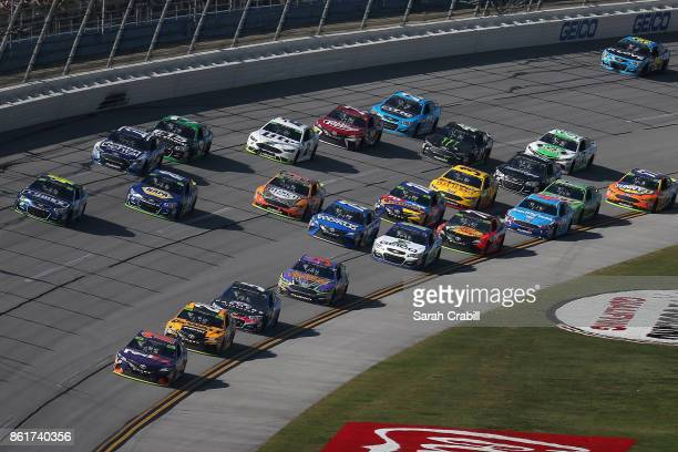 Denny Hamlin driver of the FedEx Ground Toyota leads a pack of cars during the Monster Energy NASCAR Cup Series Alabama 500 at Talladega...