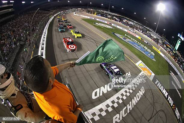 Denny Hamlin driver of the FedEx Ground Toyota leads the field to the green flag to start the NASCAR Sprint Cup Series Federated Auto Parts 400 at...