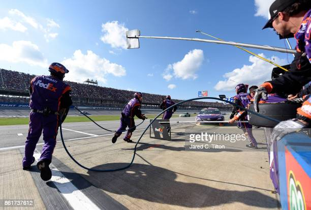Denny Hamlin driver of the FedEx Ground Toyota pits during the Monster Energy NASCAR Cup Series Alabama 500 at Talladega Superspeedway on October 15...
