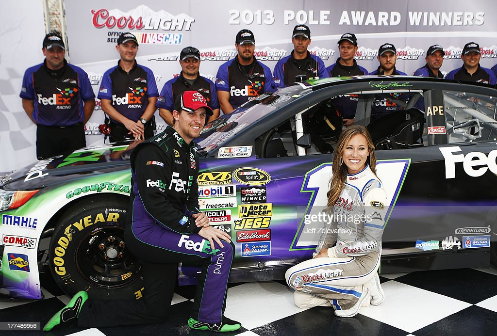 <a gi-track='captionPersonalityLinkClicked' href=/galleries/search?phrase=Denny+Hamlin&family=editorial&specificpeople=504674 ng-click='$event.stopPropagation()'>Denny Hamlin</a>, driver of the #11 FedEx Ground Toyota, poses with Miss Coors Light Rachel Rupert and the Coors Light Pole Award after qualifying for pole position for the NASCAR Sprint Cup Series IRWIN Tools Night Race at Bristol Motor Speedway on August 23, 2013 in Bristol, Tennessee.