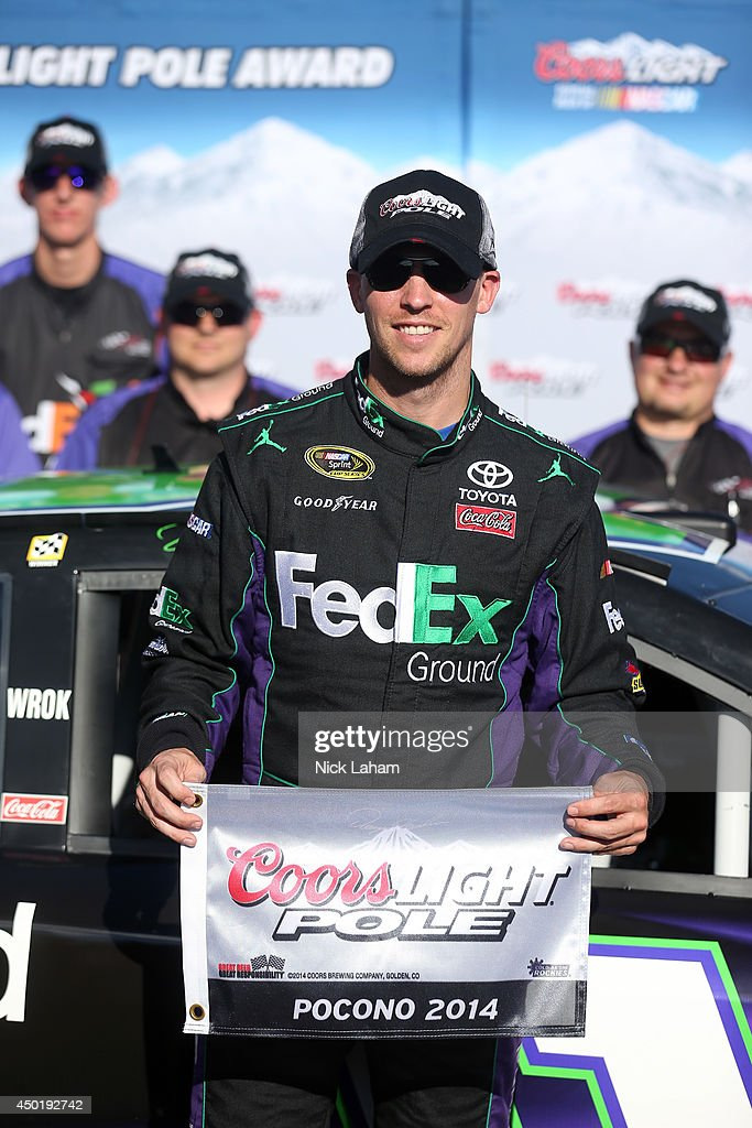 <a gi-track='captionPersonalityLinkClicked' href=/galleries/search?phrase=Denny+Hamlin&family=editorial&specificpeople=504674 ng-click='$event.stopPropagation()'>Denny Hamlin</a>, driver of the #11 FedEx Ground Toyota, poses with the Coors Light Pole Award after qualifying for the pole during qualifying for the NASCAR Sprint Cup Series Pocono 400 at Pocono Raceway on June 6, 2014 in Long Pond, Pennsylvania.