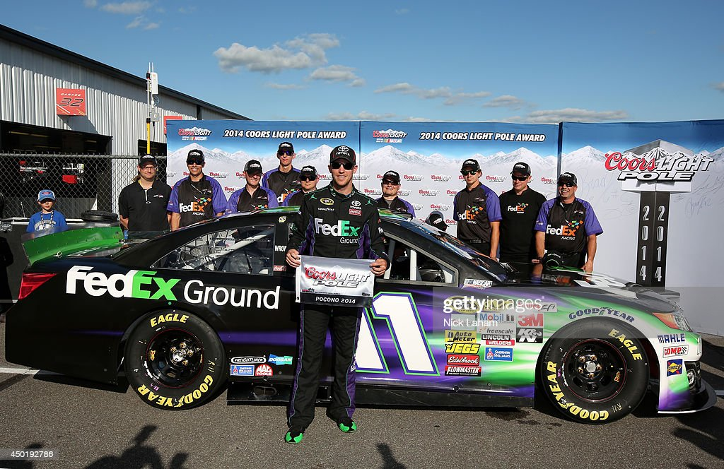 Denny Hamlin, driver of the #11 FedEx Ground Toyota, poses with the Coors Light Pole Award after qualifying for the pole during qualifying for the NASCAR Sprint Cup Series Pocono 400 at Pocono Raceway on June 6, 2014 in Long Pond, Pennsylvania.