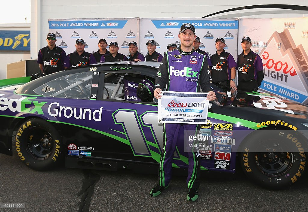 Denny Hamlin, driver of the #11 FedEx Ground Toyota, poses with the Coors Light Pole Award after qualifying for pole position for the NASCAR Sprint Cup Series Federated Auto Parts 400 at Richmond International Raceway on September 9, 2016 in Richmond, Virginia.