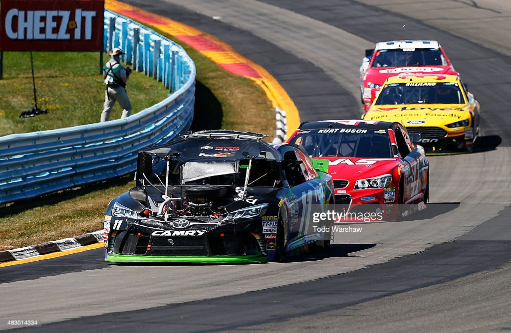 Denny Hamlin driver of the FedEx Ground Toyota races after an on track incident during the NASCAR Sprint Cup Series CheezIt 355 at the Glen at...