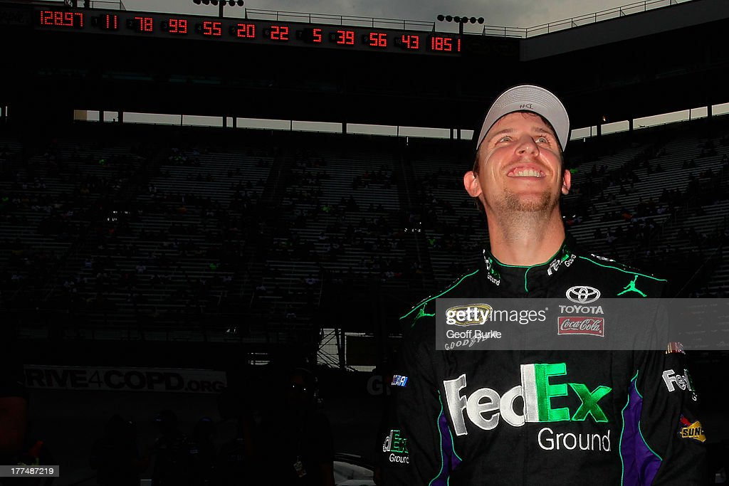Denny Hamlin, driver of the #11 FedEx Ground Toyota, reacts after qualifying for the pole for the NASCAR Sprint Cup Series IRWIN Tools Night Race at Bristol Motor Speedway on August 23, 2013 in Bristol, Tennessee.