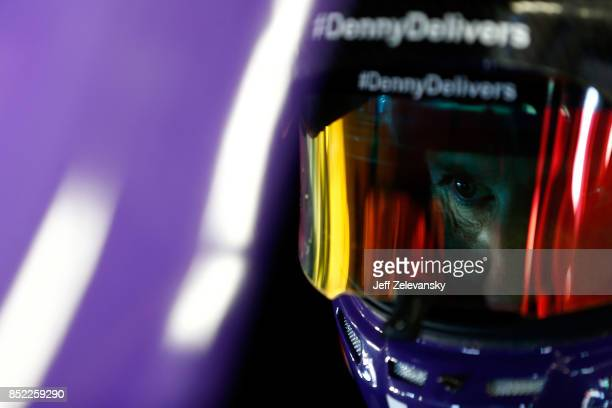 Denny Hamlin driver of the FedEx Ground Toyota sits in his car during practice for the Monster Energy NASCAR Cup Series ISM Connect 300 at New...