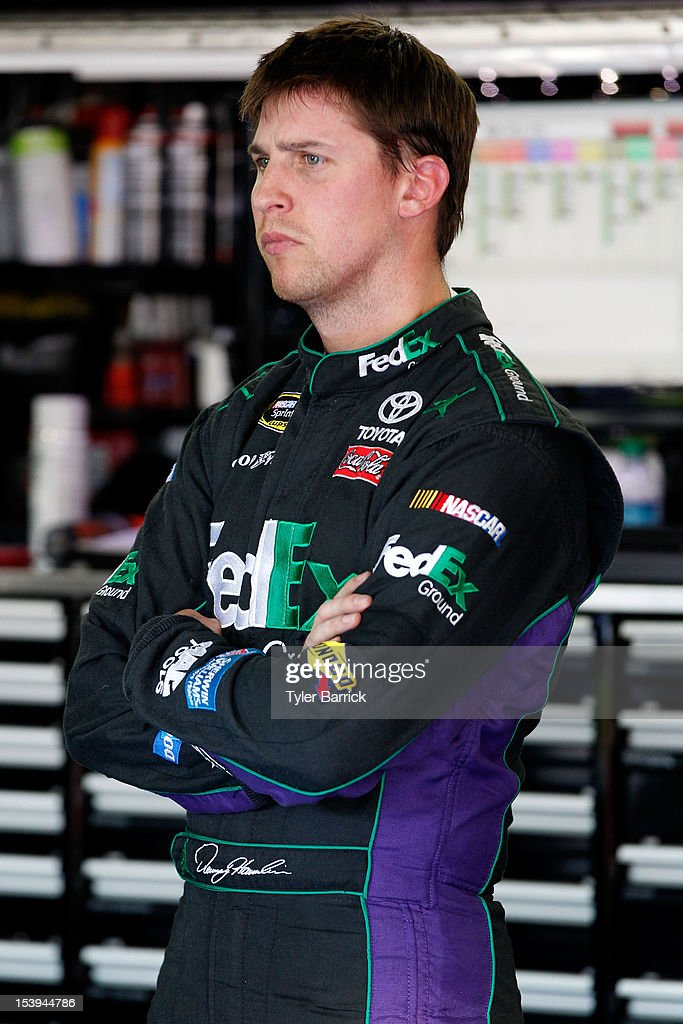 <a gi-track='captionPersonalityLinkClicked' href=/galleries/search?phrase=Denny+Hamlin&family=editorial&specificpeople=504674 ng-click='$event.stopPropagation()'>Denny Hamlin</a>, driver of the #11 FedEx Ground Toyota, stands in the garage area during practice for the NASCAR Sprint Cup Series Bank of America 500 at Charlotte Motor Speedway on October 11, 2012 in Charlotte, North Carolina.